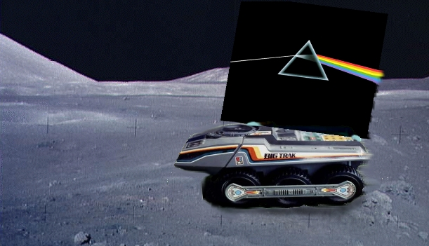 Dark Side Of The Moon, stuck on the back of a technologically superior Moon Rover, with Blu Tak, endlessly circling the moon