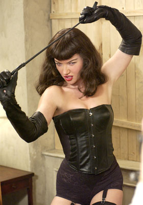 Not Bettie Page but an actress pretending to be her. In the film this shot is in Black and White